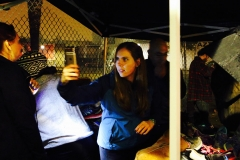 Jenn takes a photo at our Thanksgiving homeless event.
