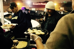 Handing out desserts to compliment the homeless Thanksgiving dinner.