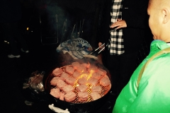 Hamburgers are cooking for our homeless event downtown San Diego.