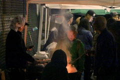 Flipping burgers and hot dogs in addition to serving Turkey on Thanksgiving for the homeless.