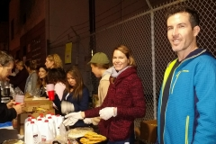 Sunshine and Alex smile as the food line volunteers for the homeless prepare to serve a Christmas meal.