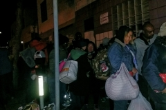 Over 150 homeless people line up for a hot Christmas meal in downtown San Diego.
