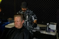 Mario from the Country Club Barber Shop cuts a homeless man's hair at our Christmas event!
