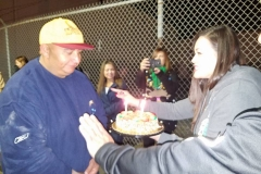 Tammy presents Dave, our homeless friend, with a birthday cake at our Christmas event.