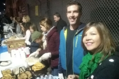 Emma and Denis help serve the homeless on streets in downtown San Diego.