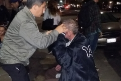 Leland, Streets of Hope San Diego Chiropractor adjust a homeless man back.
