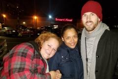 Deborah, Keshia and Joe staying warm at Streets of Hope San Diego homeless Christmas event.