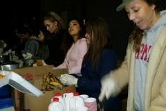 Feeding the homeless at the Streets of Hope San Diego Christmas event.