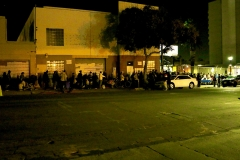 A view from across the street at our Christmas event as the homeless line up for a hot meal.