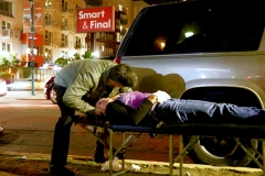 Leland, our Streets of Hope San Diego chiropracter, gives a homeless woman an adjustment.
