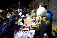 The homeless go through the Christmas meal line on the streets of San Diego.