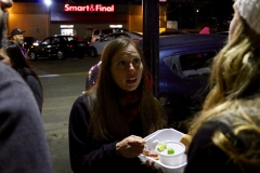 Jenn helps a homeless woman with her Christmas meal.