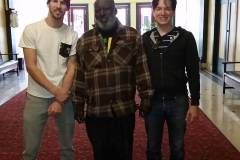 Joe, Milton and Dan stand in the lobby of the Golden West Hotel downtown San Diego.