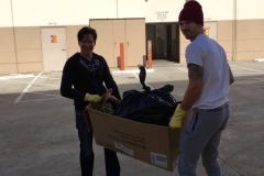 Dan and Joe taking out trash from Milton's storage unit.