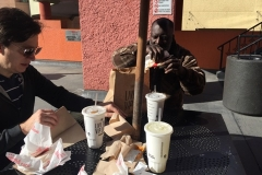 Celebrating Milton getting off the streets of San Diego with a Taco Bell feast.