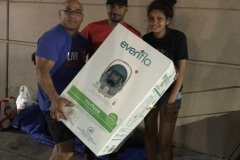 San Diego Streets of Hope volunteer gives Justin and Maria a baby car seat to get newborn Michael out of the hospital.