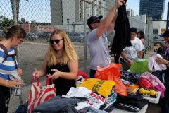 Preparing some of the clothes for the homeless in downtown San Diego.