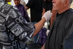 Mario cuts a homeless man's hair in downtown San Diego.