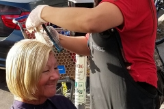 Tammy cuts a homeless woman's hair in downtown San Diego.