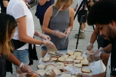 Anne and Grace putting sandwiches into bags to feed the homeless on 9/11