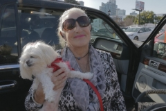 Diane and Gizelle help unload a car full of supplies for the homeless in downtown San Diego.