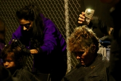 Cutting the homeless hair in the dark to cell phone flashlights on Thankgiving