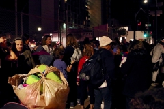 The women volunteers of the Streets of Hope San Diego pass out clothes to homeless women.