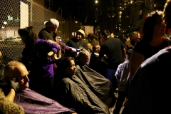 The homeless get their hair cut on the streets of San Diego downtown