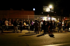 Thanksgiving food line for the homeless begins to form.