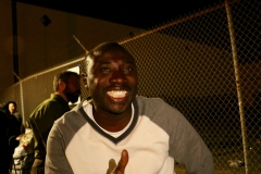 Streets of Hope San Diego volunteer Conrad smiles as he sees all the smile of the homeless at our Thanksgiving event.