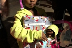Little homeless girl Christiana gets another Christmas present after getting a bike and a helmet.