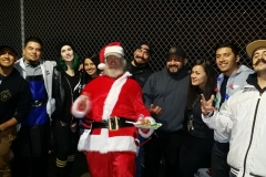 Santa and the homeless hair cutting crew at our Christmas homeless event.