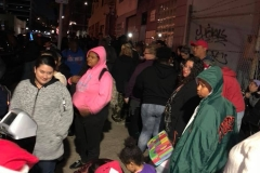 The homeless kids downtown open their Christmas gifts.
