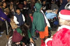 Homeless kids line up to get their Christmas gift at our homeless Christmas event.
