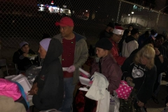The homeless are helped by Streets of Hope volunteers on Christmas in our clothing donations area.
