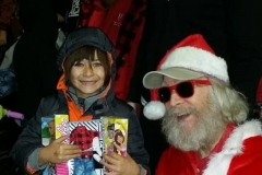 Look at that smile on a little homeless girl after Streets of Hope Santa and Dan gave her Barbie and Ken doll gifts.
