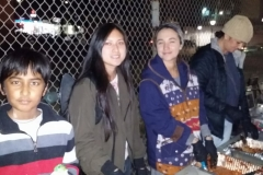 Serving the homeless by feeding them in the food line on Christmas.