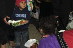 Homeless kids eat a hot meal at our Christmas event.
