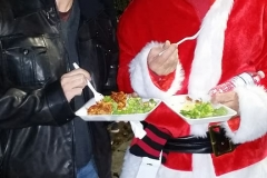 Tammy and Santa both eat a hot meal along with the homeless on Christmas.