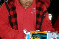 A homeless boy opens his Christmas gift at our special Christmas homeless event.