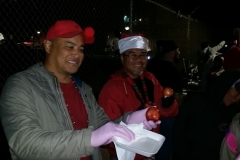 Our volunteers always wear gloves and smiles when feeding the homeless downtown.