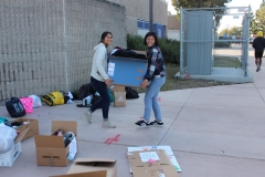 All smiles as the Acts of Kindness Team at Mira Mesa High School collect clothing donations for San Diego's homeless