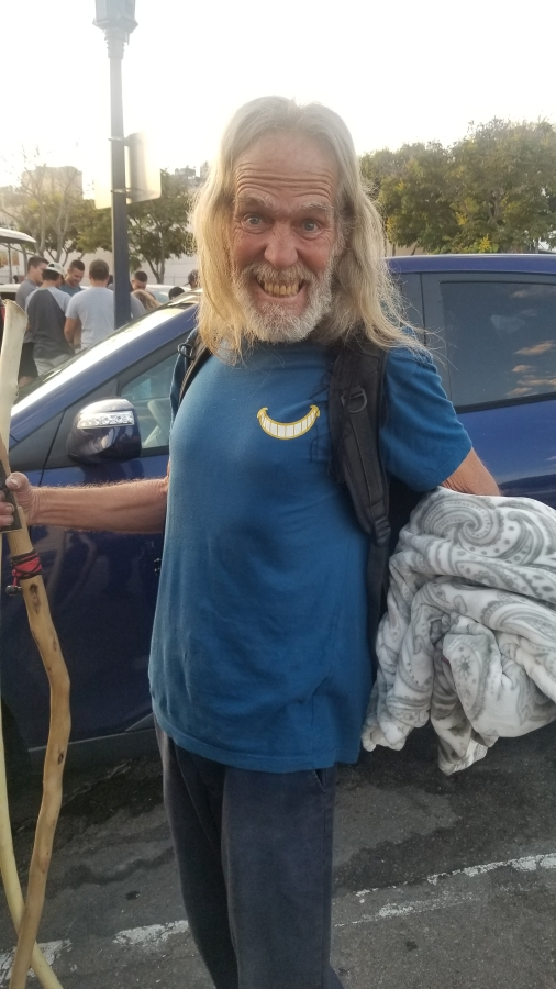 A homeless man appreciates his blanket donated by Newport Pacific.