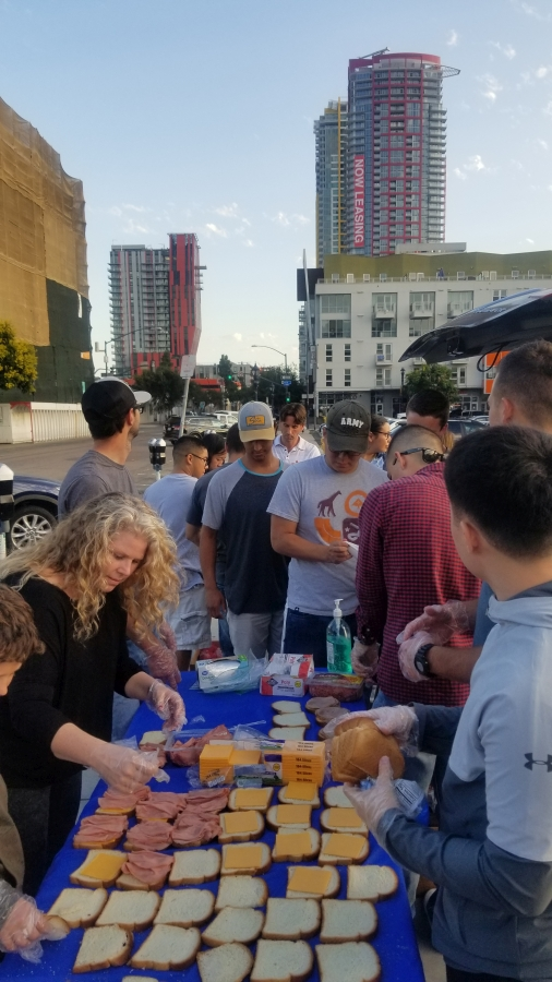 Making sandwiches for the homeless on the streets of San Diego