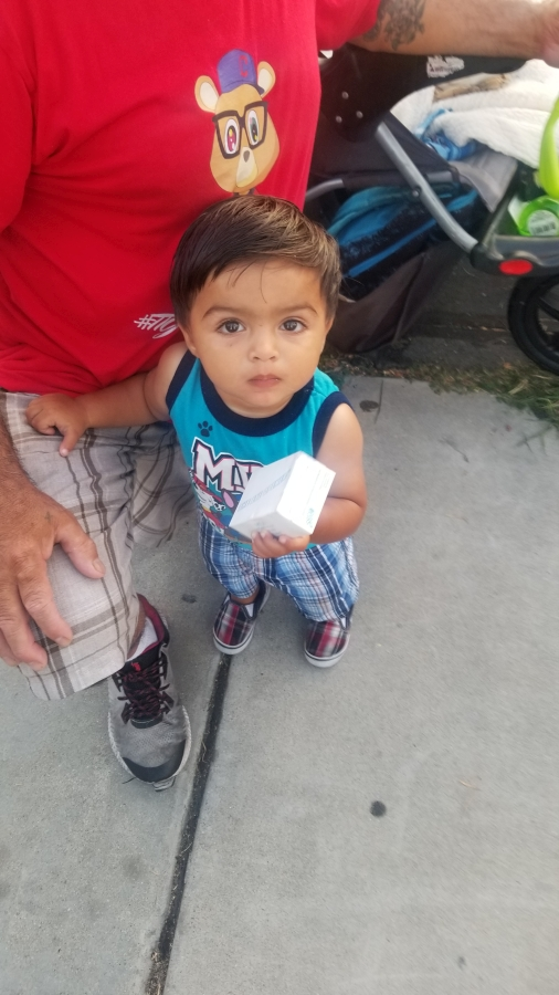 Little Antonio loved holding a bar of soap donated by Newport Pacific.