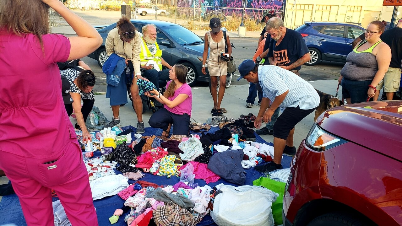 Some downtown San Diego's homeless receiving clothing, blanks and toiletries donated by Newport Pacific