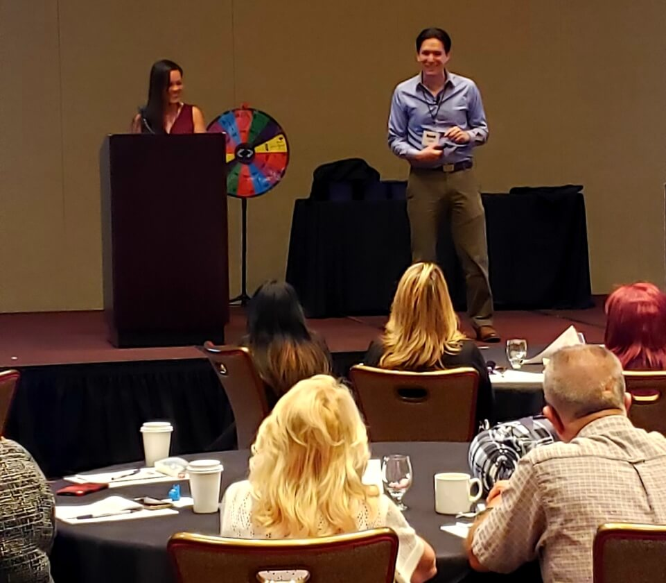 Tammy and Dan answer questions from the Newport Pacific staff after their San Diego homeless presentation.