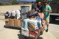 Zo and Nate begin to fill up the truck with some of the donations from Newport Pacific
