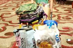 Nate wheels out a palette full of donations for San Diego's homeless from Newport Pacific