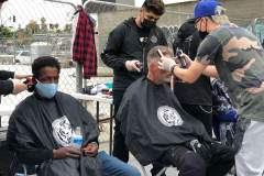 Country Club Barber shop cutting the homeless hair on the streets in downtown San Diego